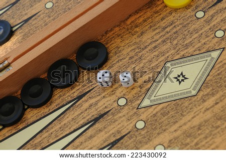 Wooden Backgammon game board with cubes and dices - stock photo
