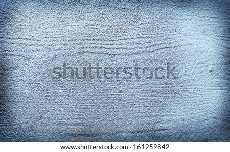 Wooden background lightly powdered with snow.