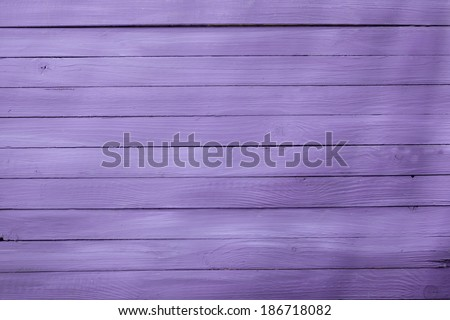 Wooden background texture in a 2014 fashion color of a pretty shade of lilac or purple with parallel horizontal boards or cladding - stock photo