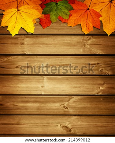 wooden background with autumn maple leaves - stock photo