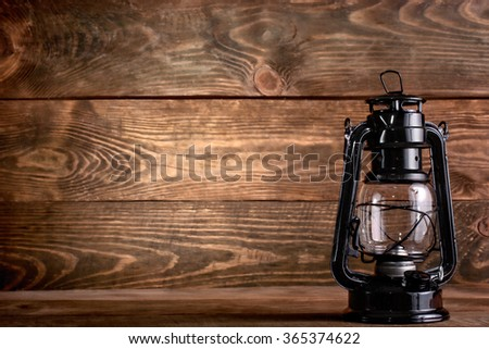 Wooden background with gas lamp