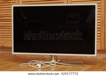 Wooden background with LED TV. LED TV on wooden background