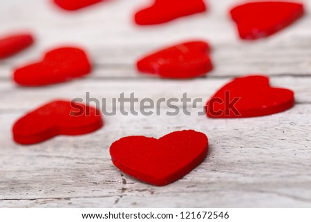 wooden background with red heart.selective focus