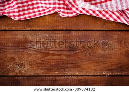 Wooden background with red napkin. Food cooking background, pizza, picnic and restaurant menu concept - stock photo