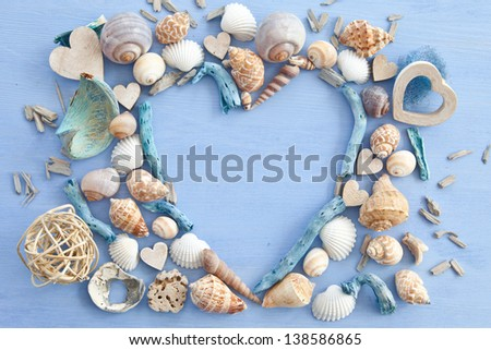 Wooden background with sea shells and hearts