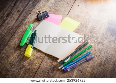 Wooden background with two blank colorful sticky notes , notebook ,pencil ,highlighter Pen, clip - stock photo