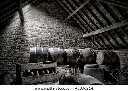 wooden barrels at an attic - stock photo