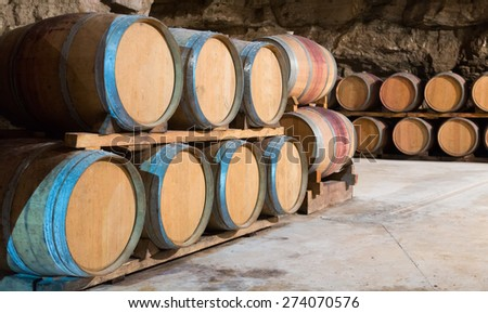 wooden barrels in rows at  winemaker factory  - stock photo