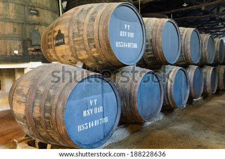 Wooden barrels used for port wine aging in Porto, Portugal - stock photo