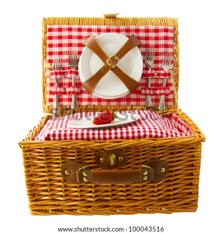 Wooden basket for picnic with plates and a strawberry isolated over white - stock photo