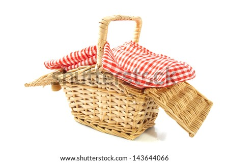 Wooden basket with cloth isolated over white - stock photo