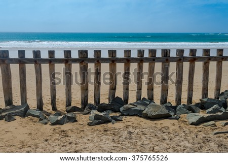 Wooden Beach Fence and Beach Scene in Anglesea, Great Ocean Road, Australia