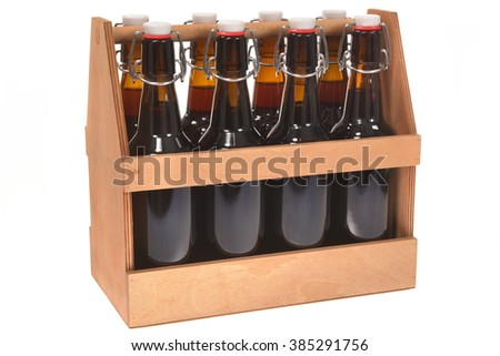 wooden beer crate with clip closure beer bottles isolated on white - stock photo