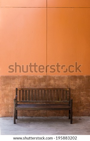 Wooden bench for relaxing - stock photo