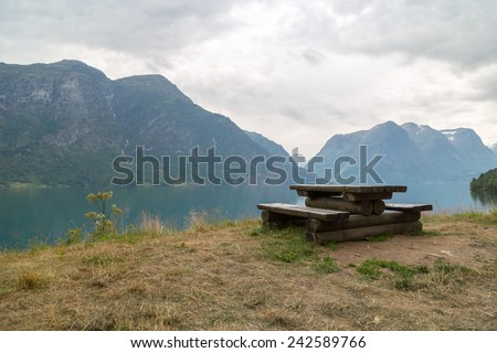 Wooden bench in a norwegian fjord