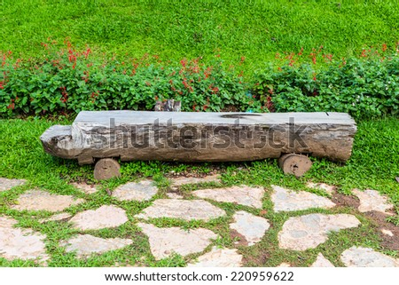 Wooden Bench in a Park - stock photo