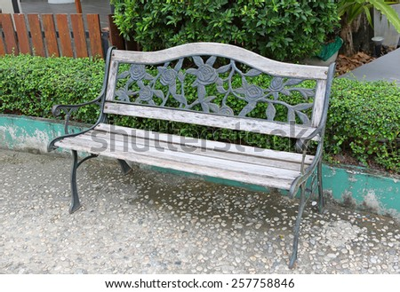 wooden bench in park - stock photo