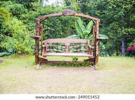 Wooden bench in the garden - stock photo