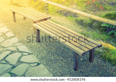 Wooden bench in the park ( Filtered image processed vintage effect. ) - stock photo