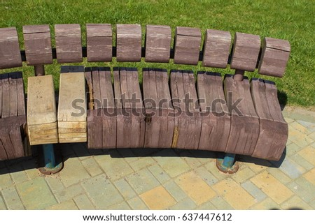 Wooden bench in the street
