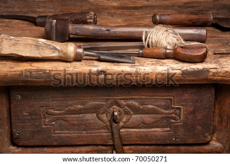 ancient wooden tools. wooden bench with rusty grungy tools and handles ancient u