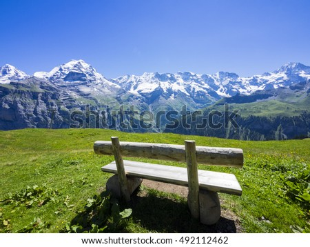 Wooden bench with the Eiger on the background, Jungfrau region, Switzerland