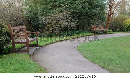 Wooden Benches and Pathway in a Park in Spring - Namely Victoria Park in Bath England - stock photo