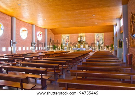 wooden benches inside a beautiful church - stock photo