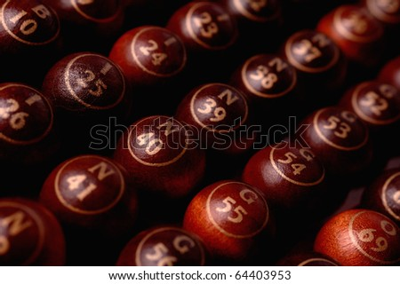 wooden bingo balls in a row - stock photo