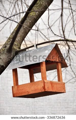 wooden bird feeders, birdhouse - stock photo