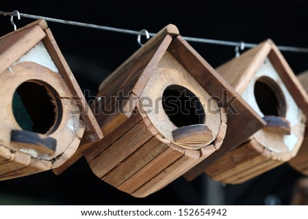 wooden bird house background. - stock photo