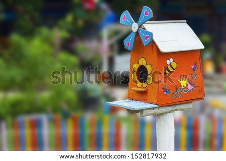 wooden bird house in garden - stock photo