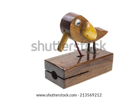 Wooden bird knocking on white background. - stock photo
