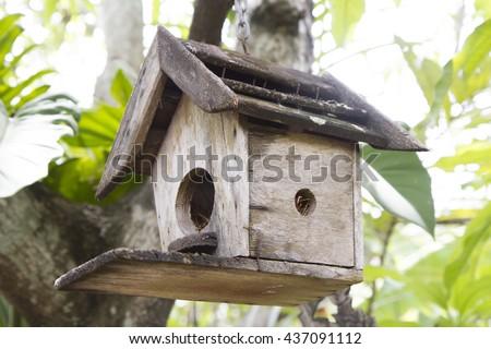 wooden Birdhouse in the big tree garden - stock photo