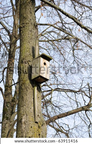 Wooden Birdhouse on Tree - stock photo