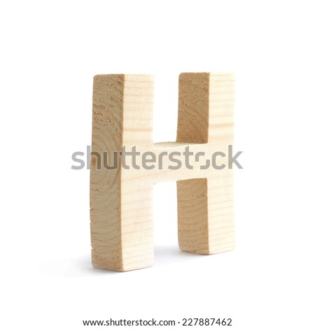 Wooden block H letter isolated over the white background