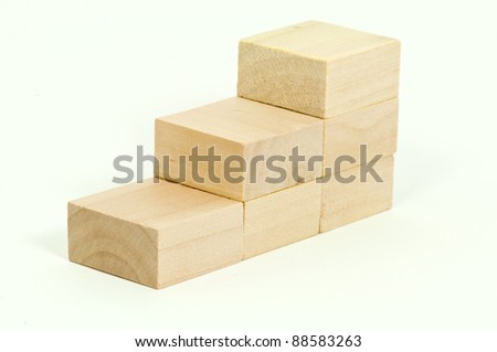 Wooden block stairs against white background - stock photo
