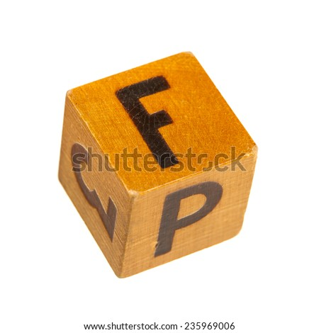 Wooden block with capital F letter isolated over white background. Shallow depth of field