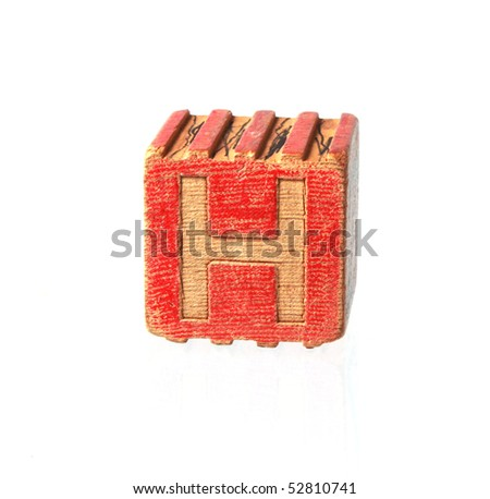 Wooden block with letter H