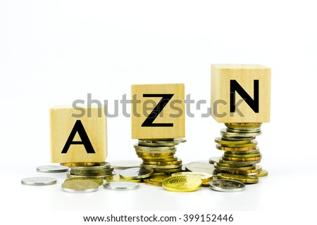 Wooden block with stacked coins with word AZN (Azerbaijan Manat) country currency code - stock photo