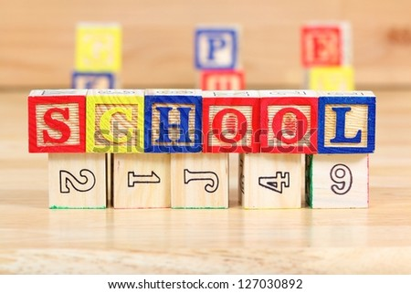 Wooden blocks with letters. Children educational toy concept - the word school. - stock photo