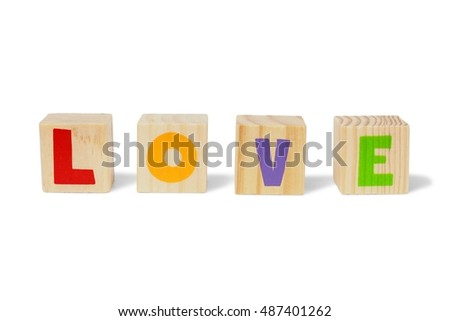 Wooden blocks with LOVE isolated on white background