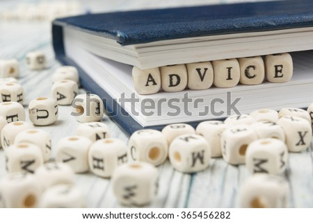 Wooden Blocks with the text Advice - stock photo