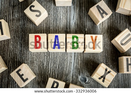 Wooden Blocks with the text: Baby