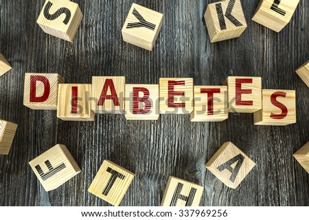 Wooden Blocks with the text: Diabetes - stock photo