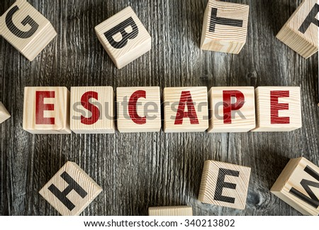 Wooden Blocks with the text: Escape