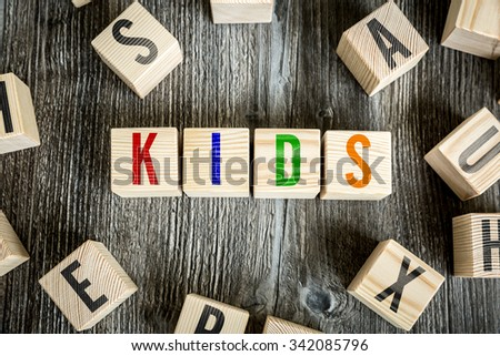 Wooden Blocks with the text: Kids - stock photo