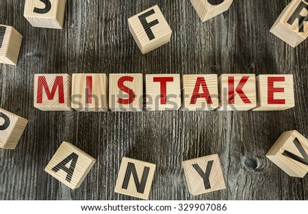 Wooden Blocks with the text: Mistake - stock photo