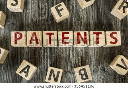Wooden Blocks with the text: Patents - stock photo