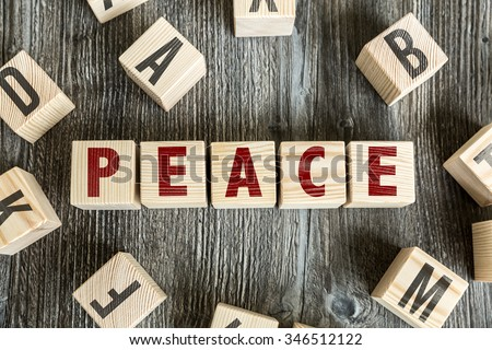 Wooden Blocks with the text: Peace - stock photo